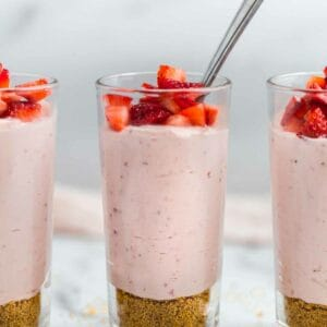 strawberry mousse in glass cup with spoon