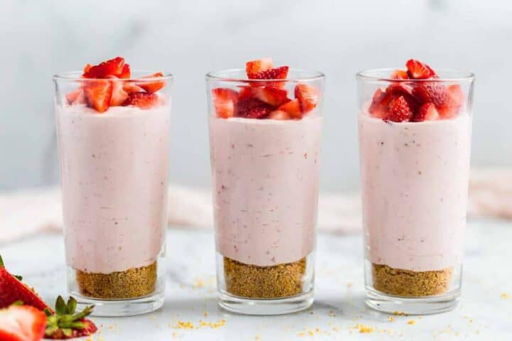 strawberry mousse in glass cups with fresh strawberries on top