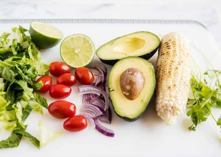 taco salad ingredients on a cutting board