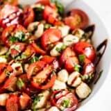 tomato basil mozzarella salad in white bowl