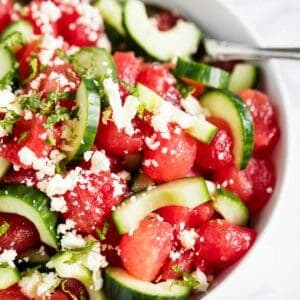 watermelon salad with cucumber in white bowl