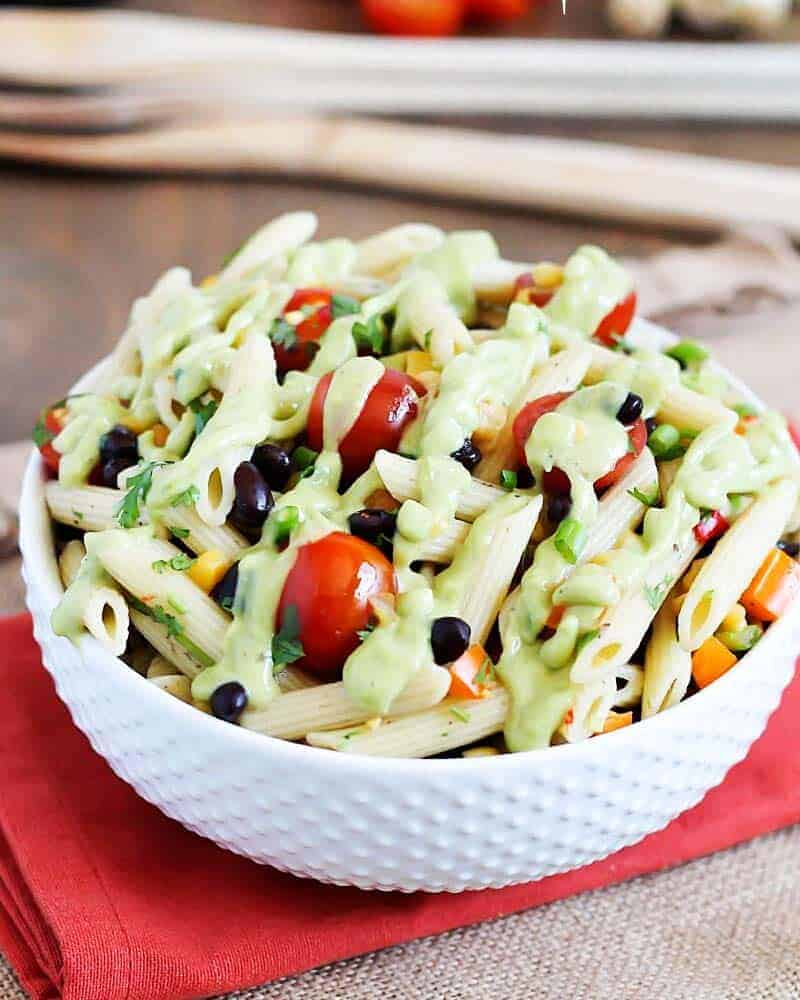 bowl of southwest pasta salad drizzled with avocado lime dressing