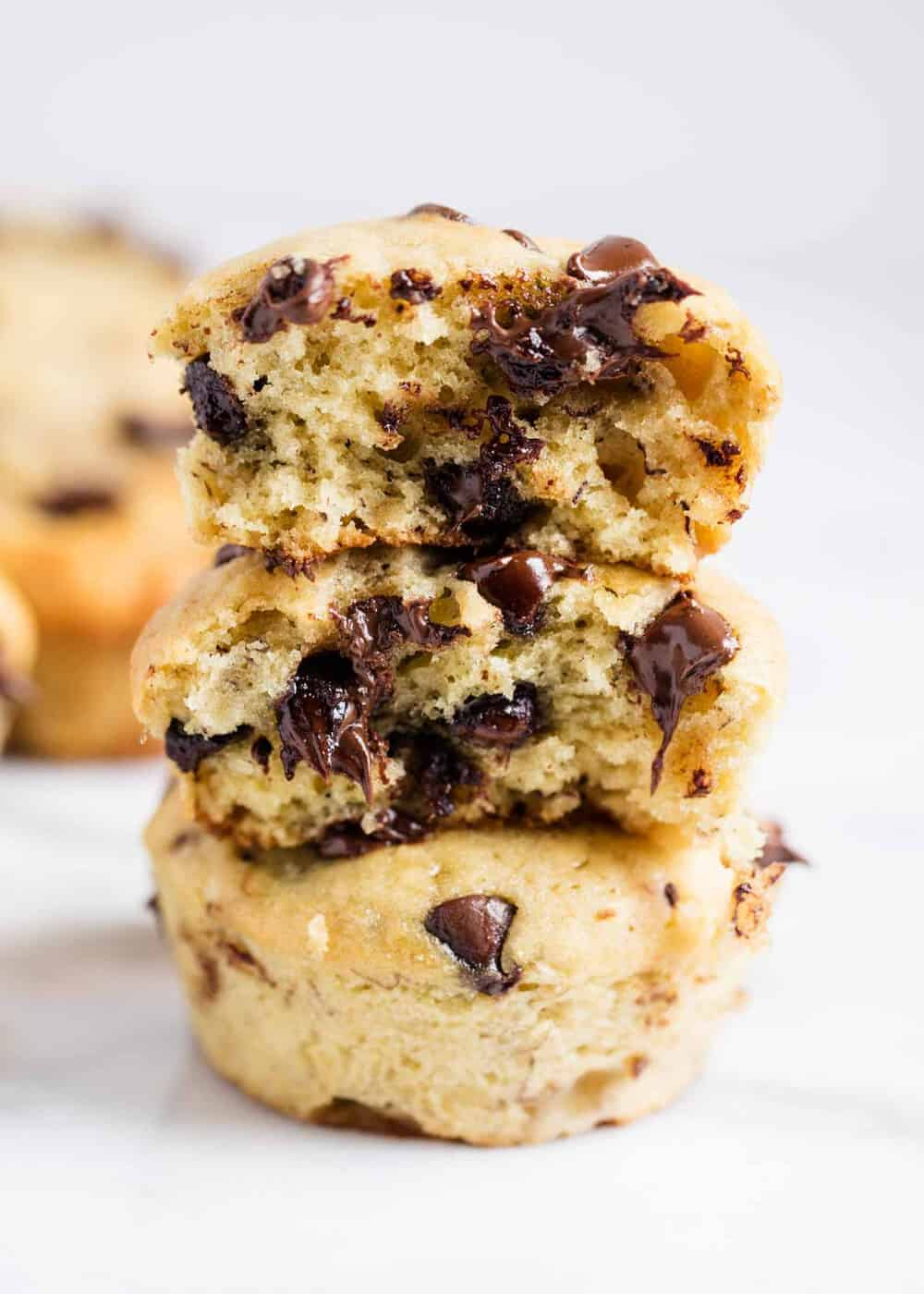 stack of chocolate chip banana bread muffins with bite taken out
