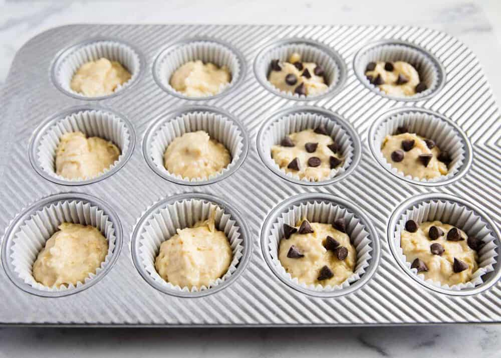 muffin tin filled with banana bread muffin batter
