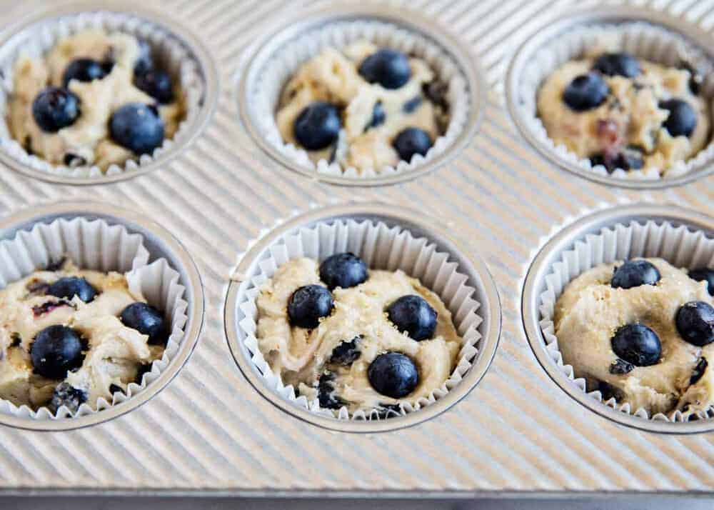 blueberry muffin batter in liners in pan