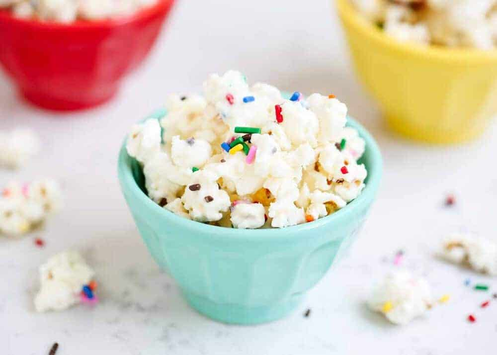 blue bowl of cake batter popcorn with sprinkles