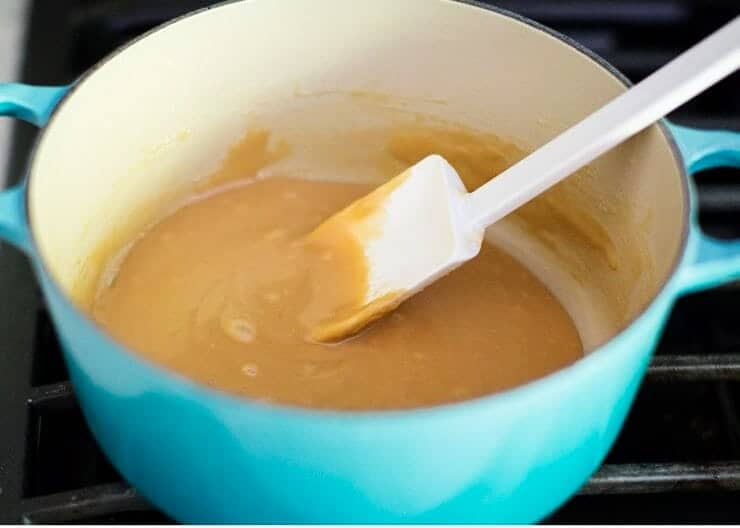 making caramel for carmelitas in a pan on the stove
