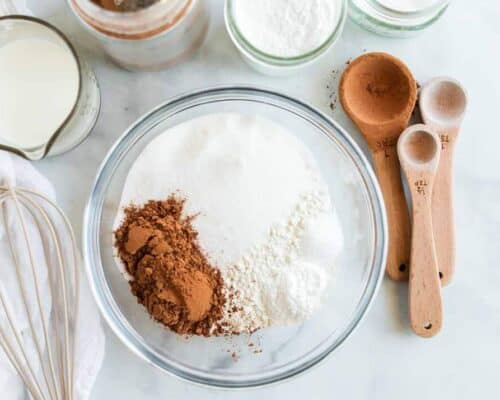 dry ingredients for chocolate cake in a glass bowl