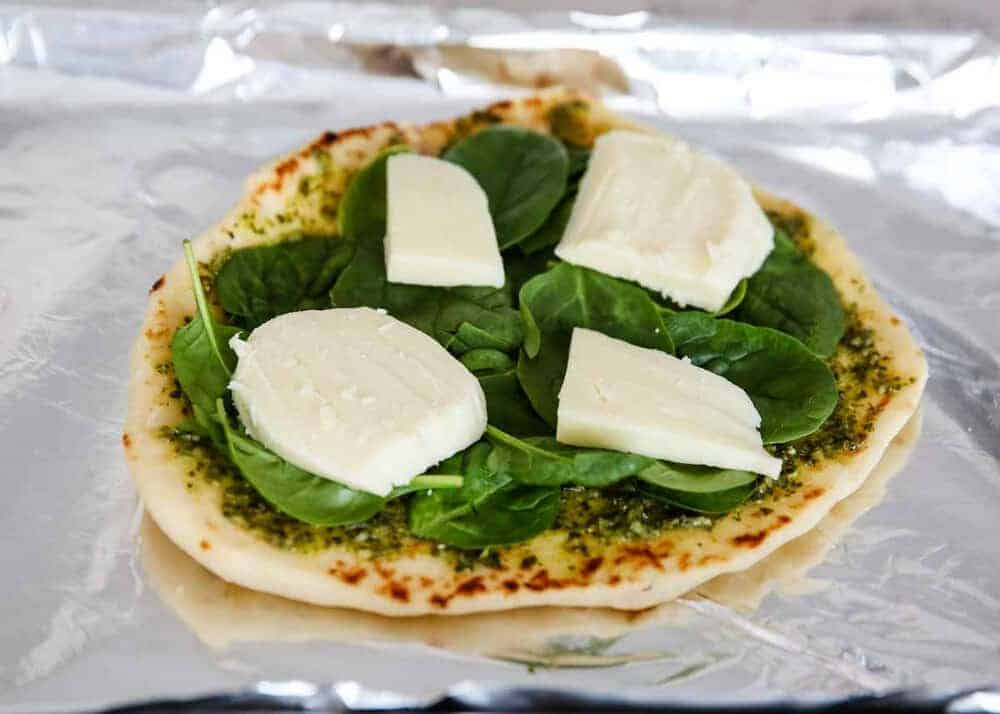 naan bread with fresh mozzerella, pesto and spinach