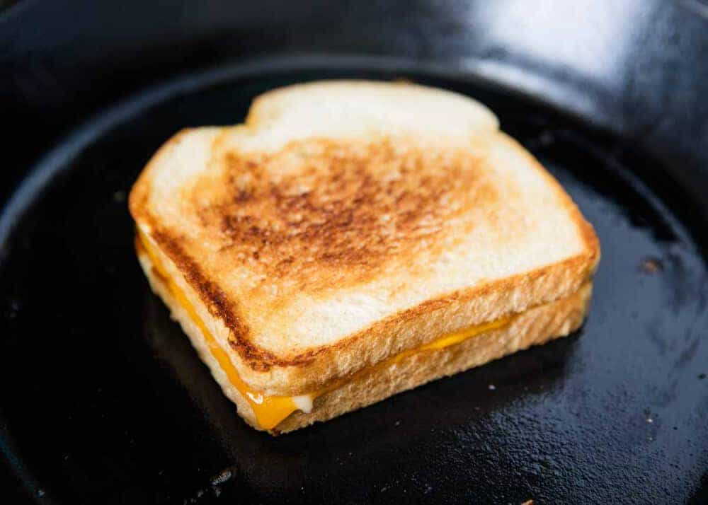 frying a grilled cheese sandwich on the skillet
