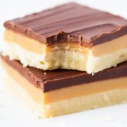 stack of twix bars with a bite taken out