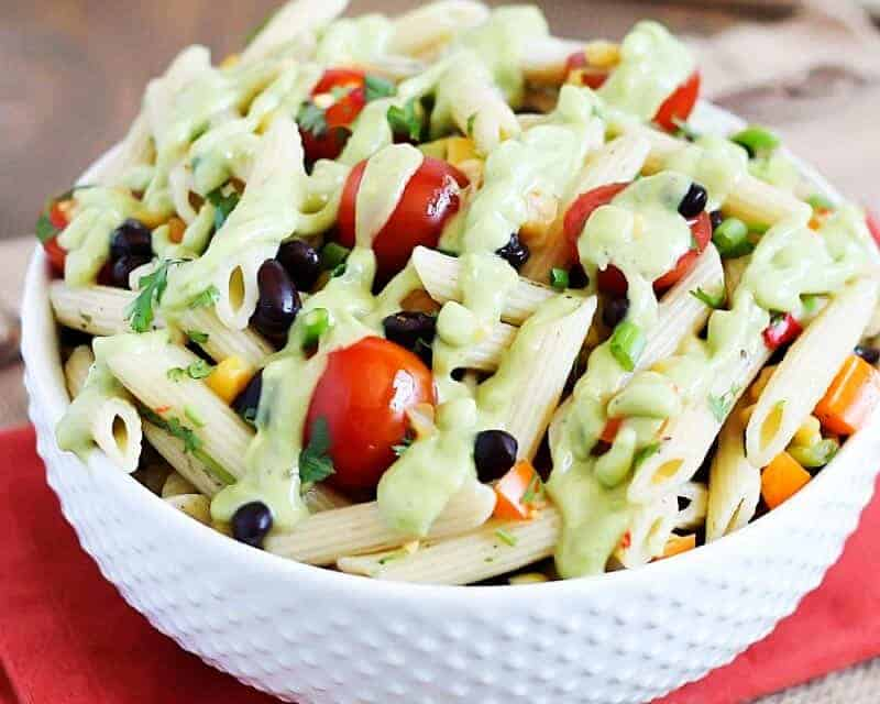 bowl of southwest pasta salad with avocado lime dressing drizzled on top