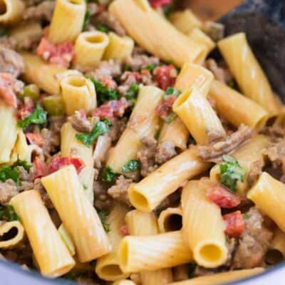 rigatoni noodles with bolognese sauce in pan