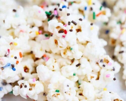 a close up of cake batter popcorn with sprinkles