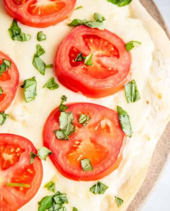 white pizza with fresh tomatoes and basil