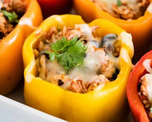 chicken stuffed peppers in a baking dish