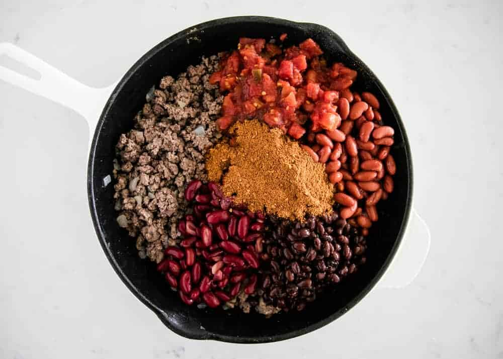 chili ingredients in a cast iron pan