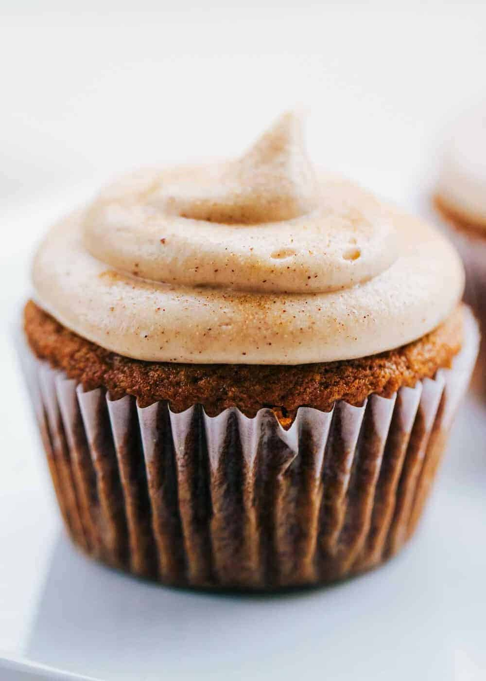 A close up of a churro cupcake