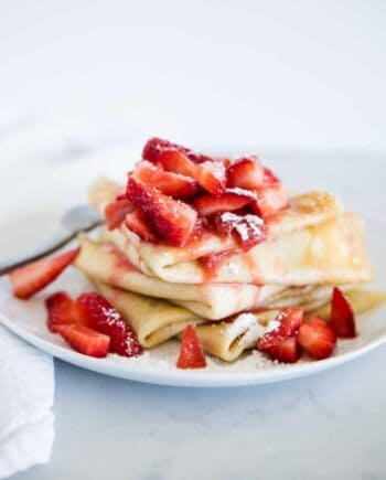 strawberry crepes on a white plate