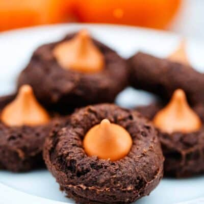 pumpkin chocolate cake mix cookies with a pumpkin Hershey kiss in the middle
