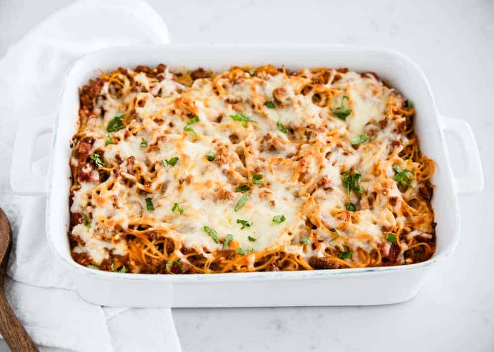 baked spaghetti in white casserole dish