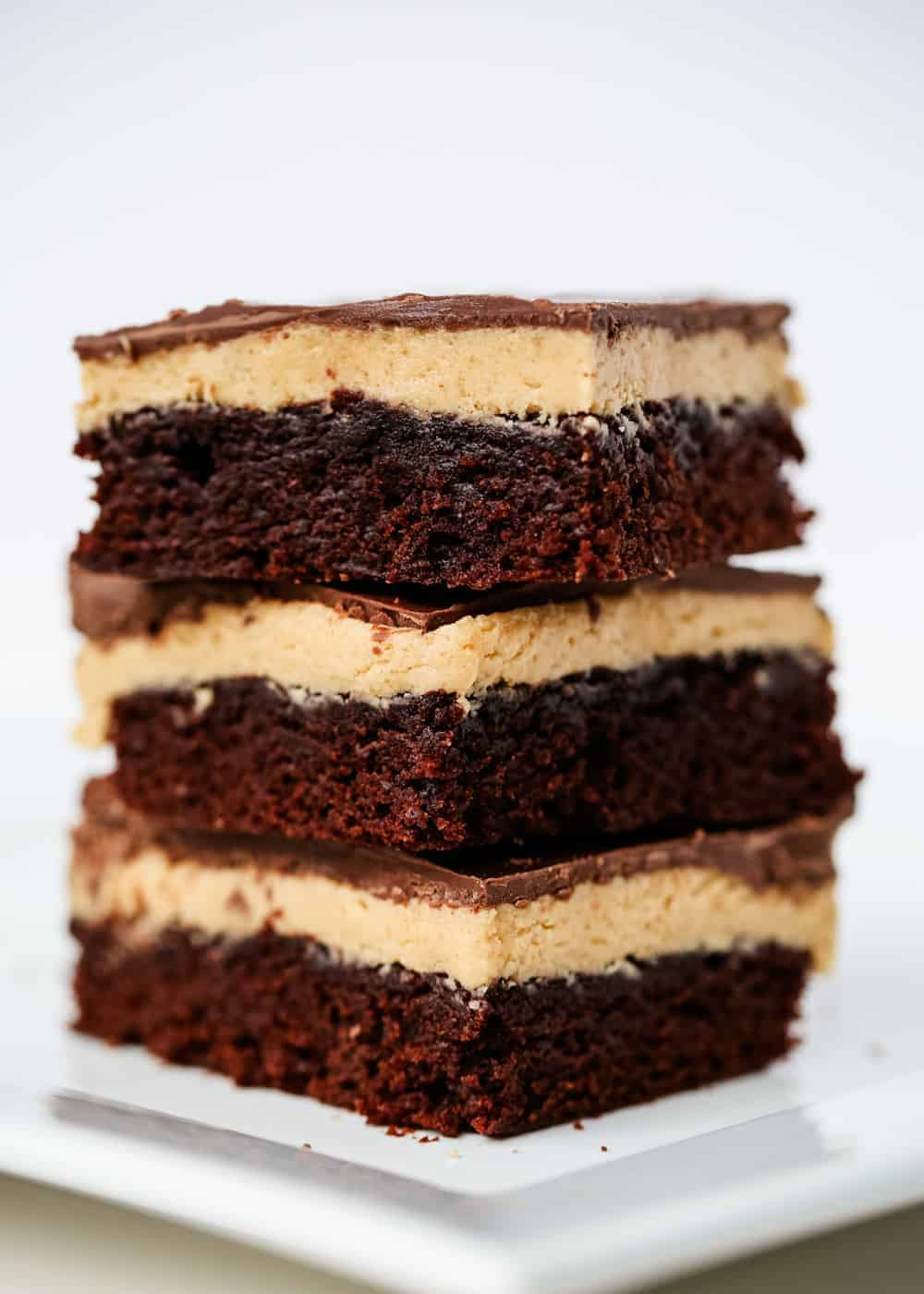 stack of buckeye brownies on a white plate