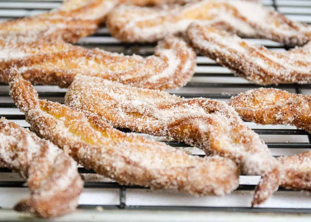 churros laying on cooling rack