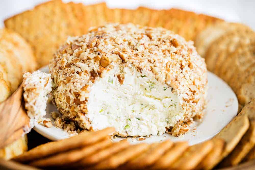 a close up of a cheese ball with crackers