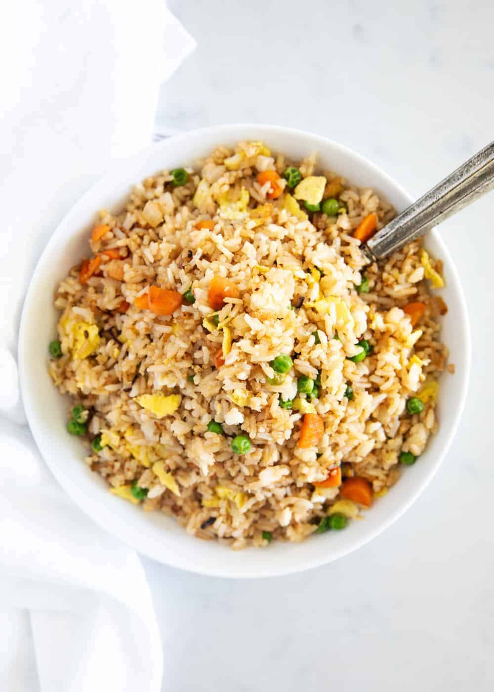 fried rice in white bowl with spoon