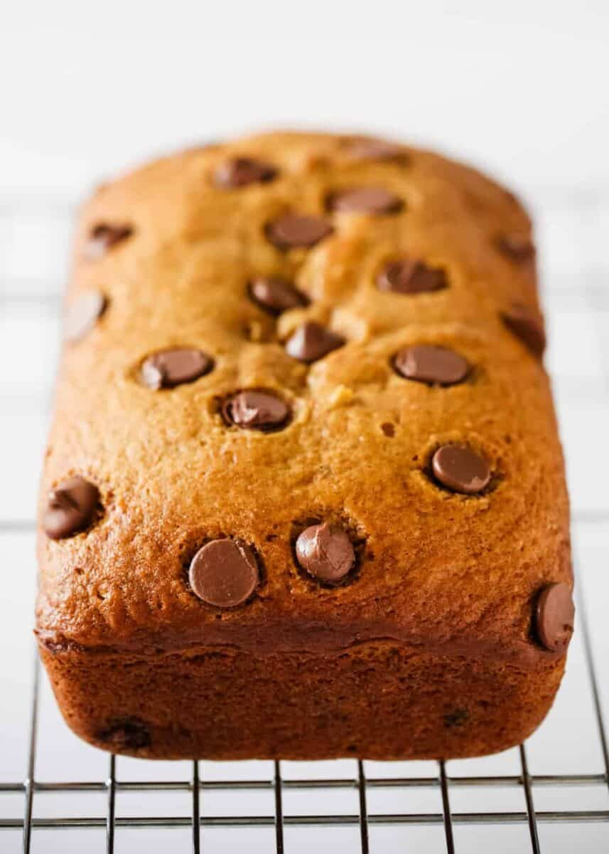 loaf of pumpkin chocolate chip bread on cooling rack