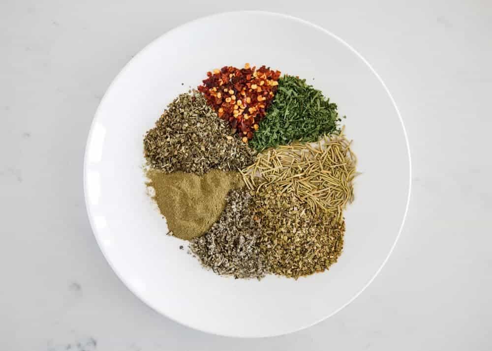 Italian seasonings on a white plate