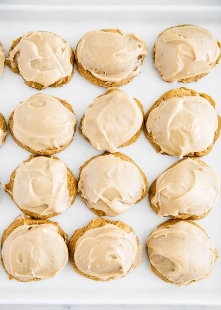 iced pumpkin cookies on a plate