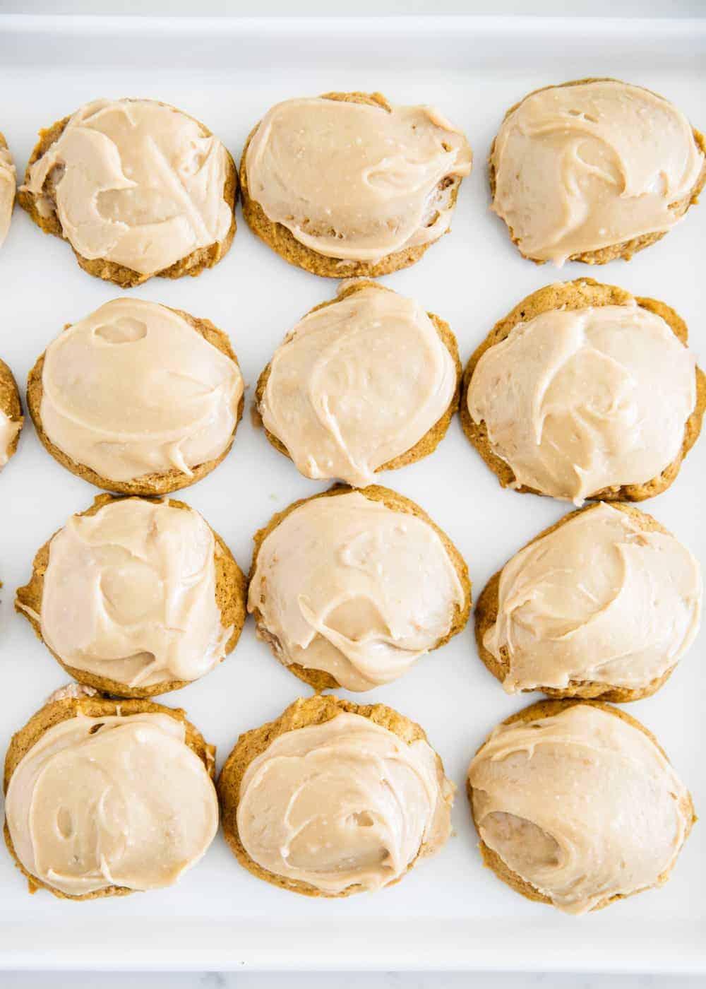 iced pumpkin cookies on a plate