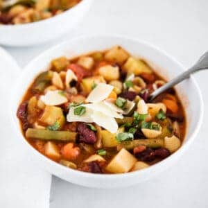 minestrone soup in a white bowl
