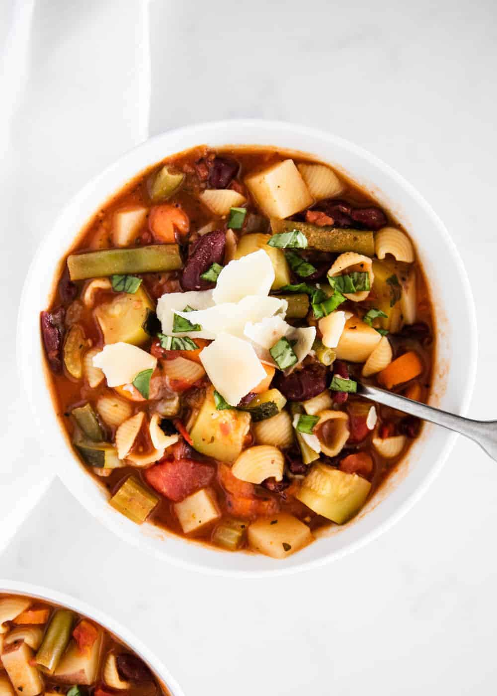 bowl of Italian minestrone soup with fresh parmesan