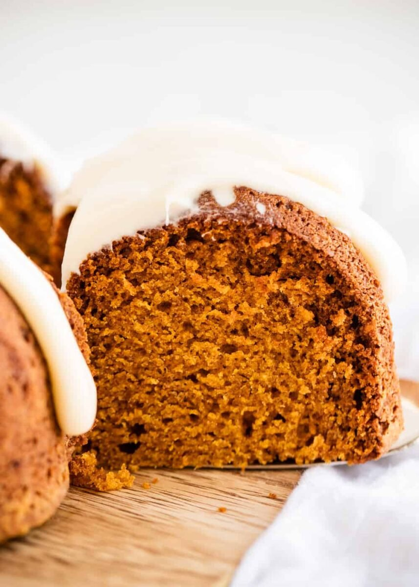 piece of pumpkin spice bundt cake with cream cheese frosting