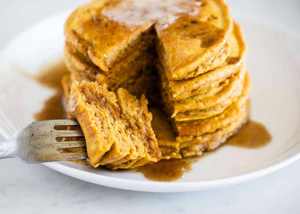 stack of pumpkin pancakes with a fork