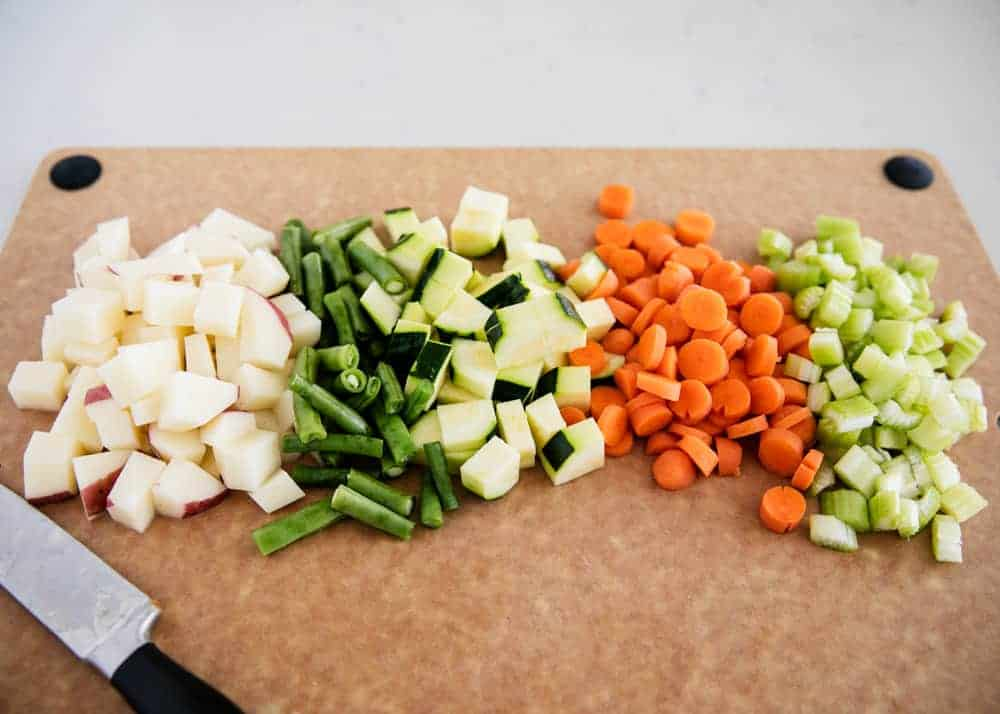 chopping veggies for minestrone soup
