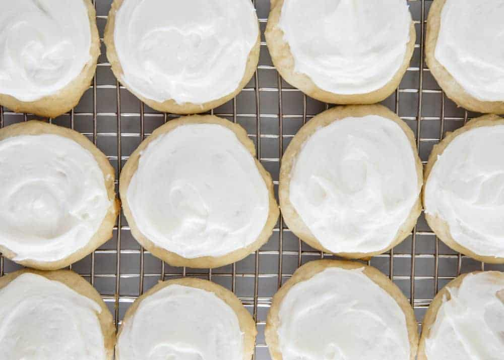 frosted ricotta cookies on a cooling rack