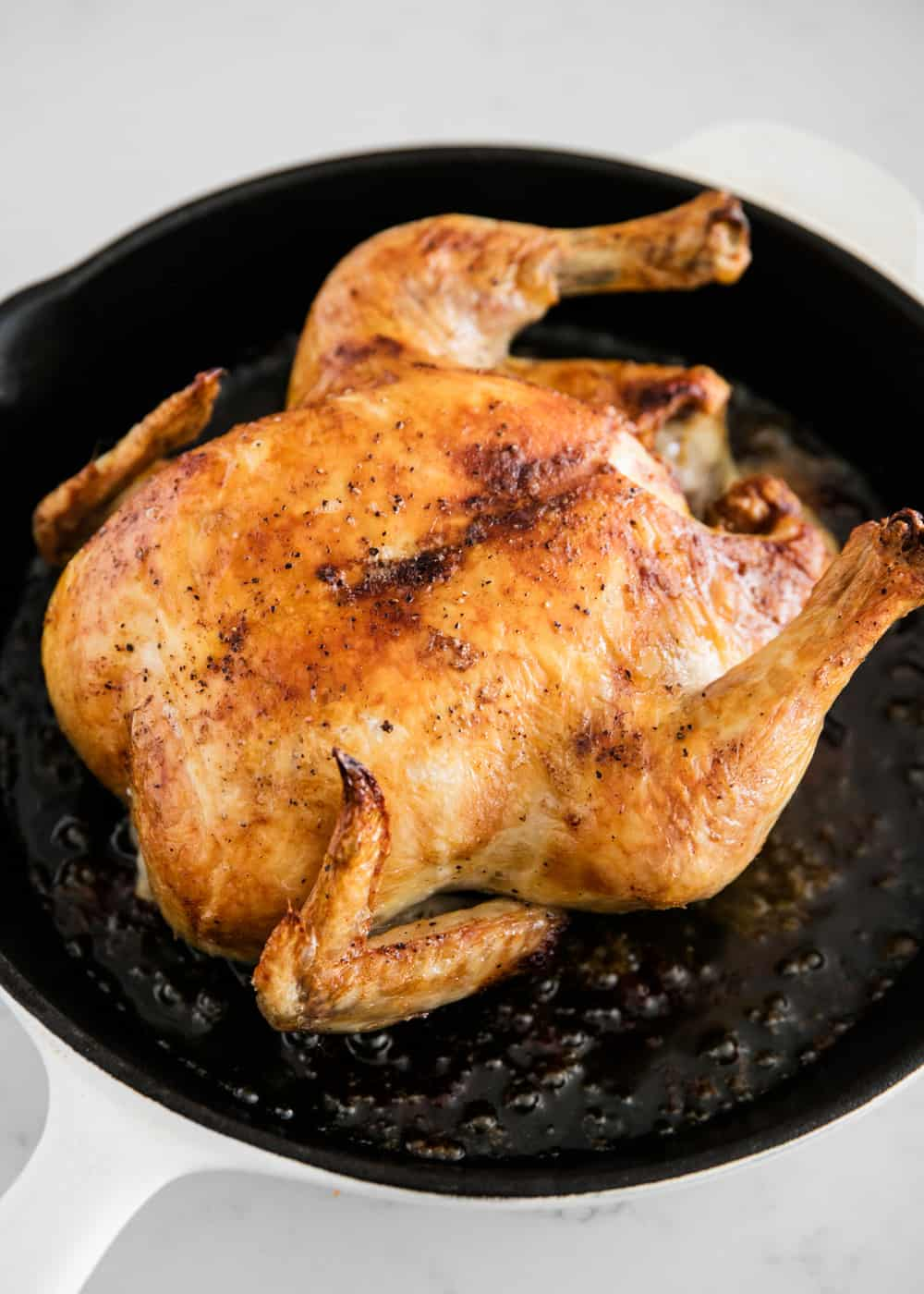 oven roasted chicken in a cast iron skillet