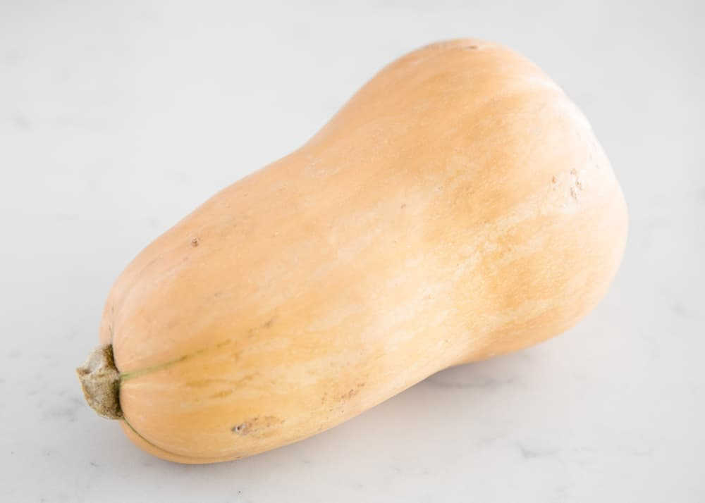 butternut squash on marble counter top