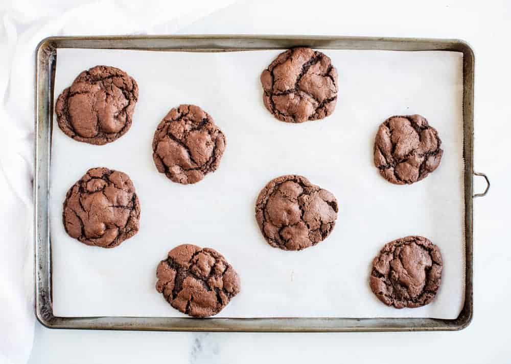 cooked chocolate cookies on a baking sheet