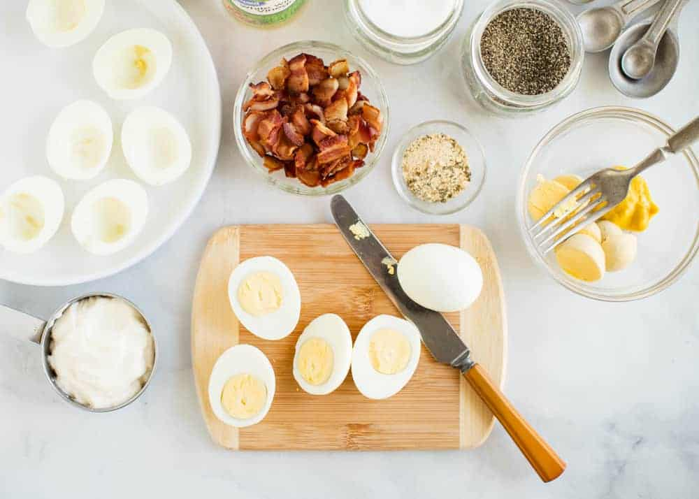 ingredients for making bacon ranch deviled eggs out on counter