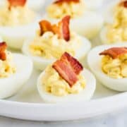 bacon ranch deviled eggs on a white plate