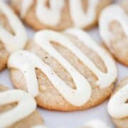 A close up of an eggnog cookie drizzled with icing