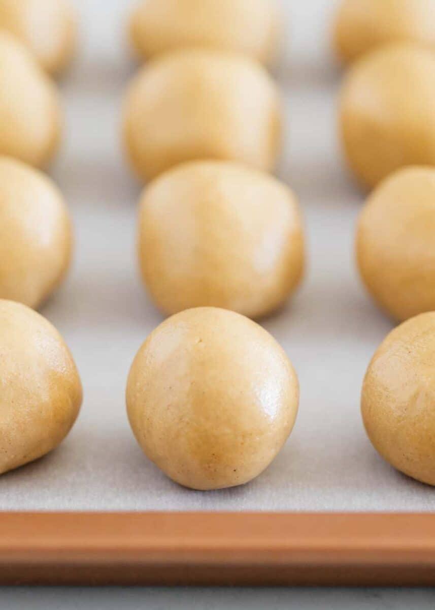 peanut butter balls on baking sheet