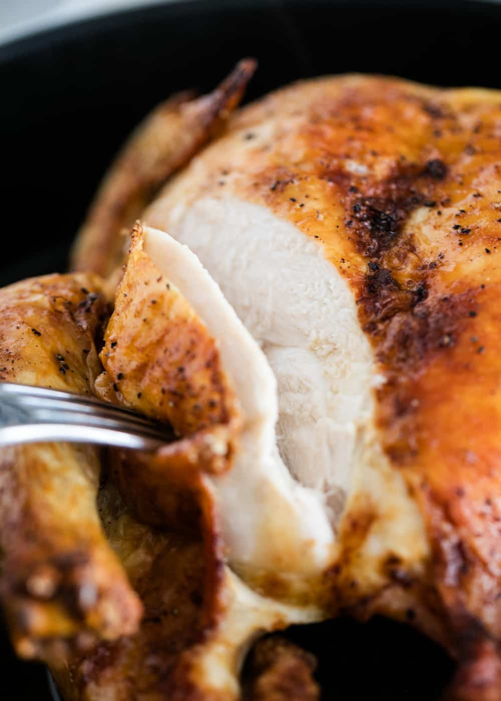 carving a baked whole chicken