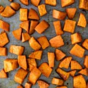 close up of roasted sweet potatoes on baking sheet