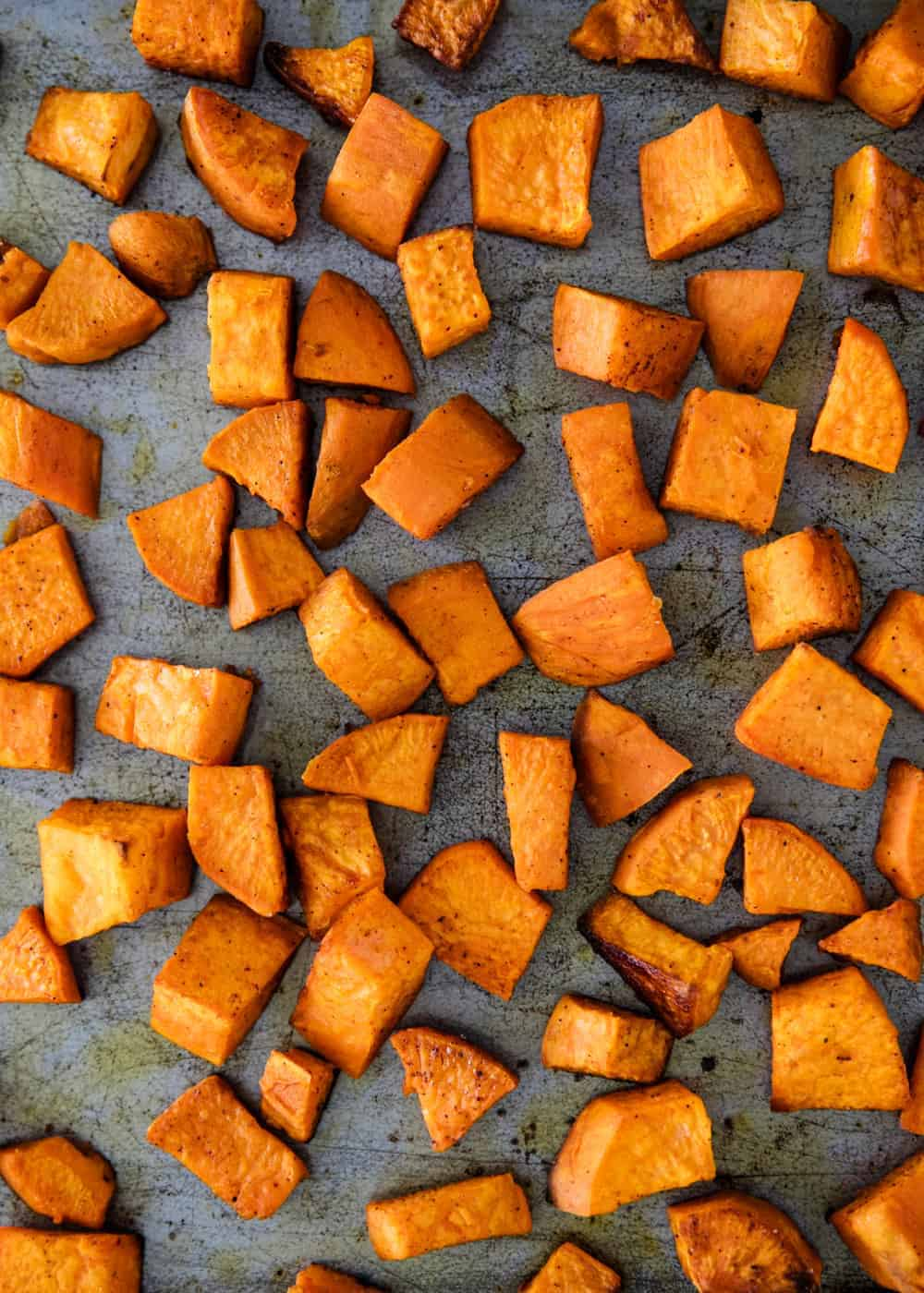 oven roasted sweet potatoes on baking sheet