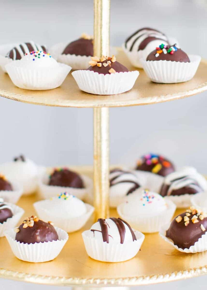 peanut butter balls on gold cake stand